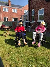 Primrose Care Home residents sitting in the garden